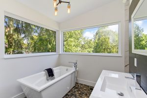 lots of light in the en-suite with the corner windows above the stand alone soaker tub